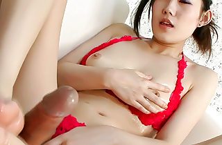 Pretty babe Yui Komine uses a sex toy to have fun with her nips and lush bra-stuffers as her man watches